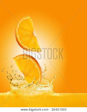 orange slices fall in juice