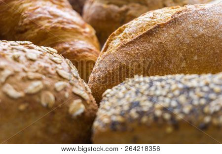 Close-up of Mixed Bread and baked Bread rolls usable as decorative Food Background. Freshly baked Whole-grain Bread Rolls.