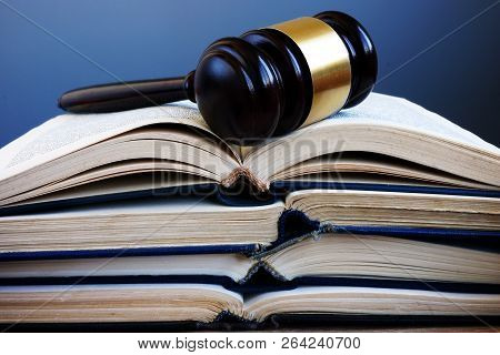 Law Book And Gavel In A Court. Lawsuit And Justice.