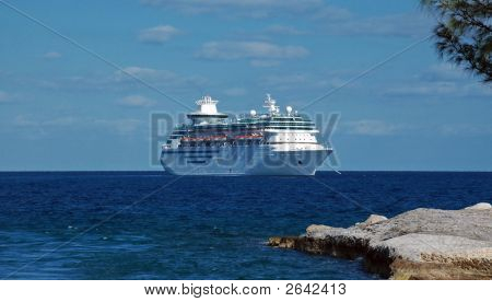 View Of Cruise Ship Anchored Off Island Shore