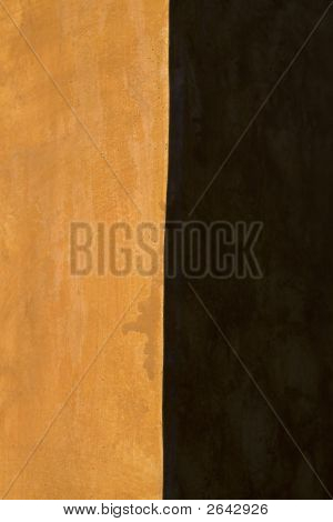 stucco wall corner with sunlight and shadow poster
