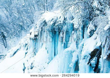 Croatia, Plitivice, Frozen Waterfalls In Winter In Popular Nature Park Plitvicka Jezera