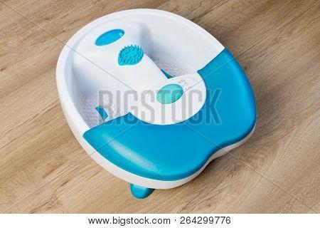Feet In A Vibrating Foot Massager. Electric Massage Bath. Foot Bath Before A Pedicure