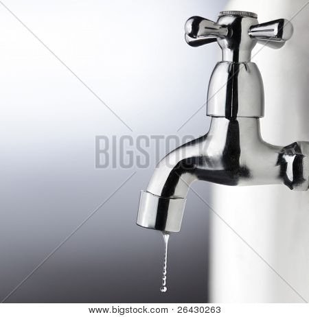 metal tap with water drop