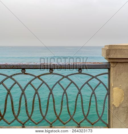 Rusted Metal Decorated Protective Fence Of Stanley Bridge At Alexandria, Egypt With Mediterranean Se