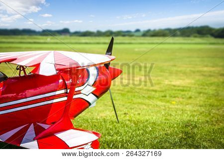 Retro Airplane Ready To Take Of On A Green Field In The Summer