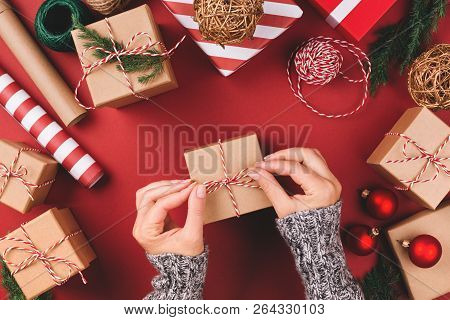 Christmas Background With Gift Boxes, Clews Of Rope, Papers Rools And Decorations On Red. Preparatio