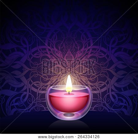 Burning Candle On The Background Of The Ornament On A Dark Blue Background