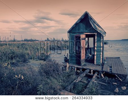 Scary Old Terrible Abandoned Hut, Wooden Creepy House On Mysterious Empty Uninhabited Swamp With Dea