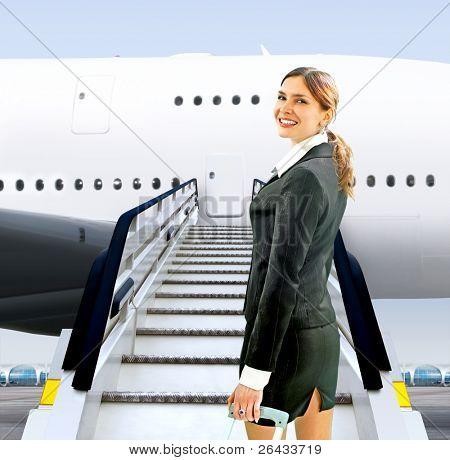 beautiful flight attendant near moving ramp in airport