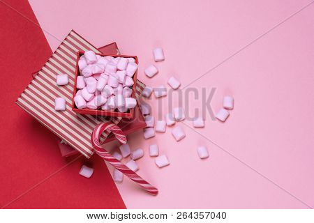 Minimalist Christmas Gifts And Sweets Image With Red Presents And An Open Box Full Of Pink Tiny Mars