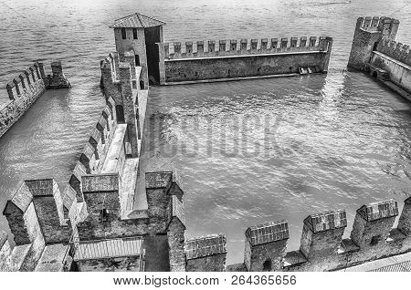 Sirmione, Italy - June 1: The Scaliger Castle In Sirmione, Italy, June 1, 2014. Surrounded By The Wa