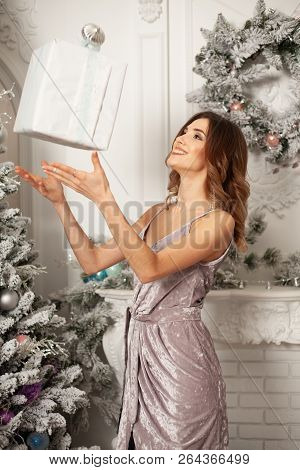 Christmas Winter Woman Holding Magic Christmas Gift Box. Beautiful New Year And Christmas Tree. Beau
