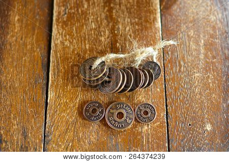Hand Holds Old Thai Satang Coins, Vintage