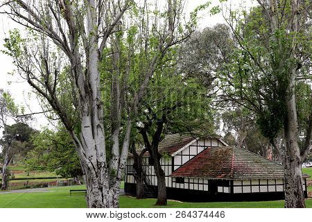 A Lone, Decrepit Building Tucked Away In The Trees Beside A River. Would Look Nice For Any Purpose,