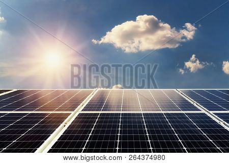 Concept Clean Power Energy. Solar Panel And Sunlight With Blue Sky Background