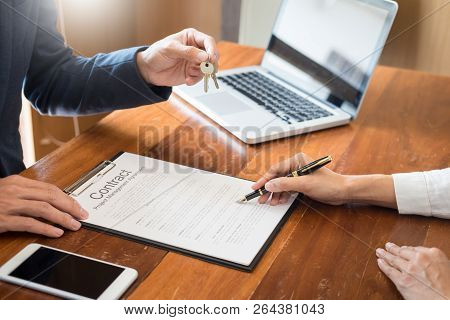 Agent Getting Keys To Customer New House, Hand Of Real Estate Agent Or Realtor Giving Apartment Key