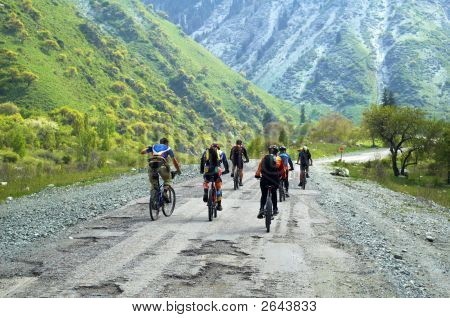 Group Of Bikers On Old Mountain Road