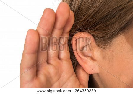 Woman Is Listening With Her Hand On An Ear - Hearing Loss Concept