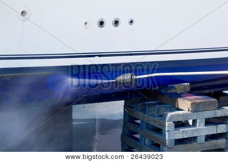 pressure washer cleaning boat hull barnacles antifouling and seaweed