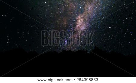 Milky Way, Trail Star Galaxy And Stars Moving Across Night Sky. Abstract Night Sky Background With S
