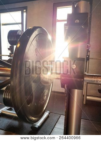Fitness Barbell Against The Sunlight With Lensflare.