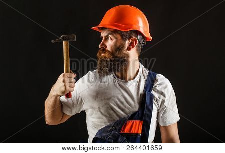 Hammer Hammering. Builder In Helmet, Hammer, Handyman, Builders In Hardhat. Handyman Services. Indus