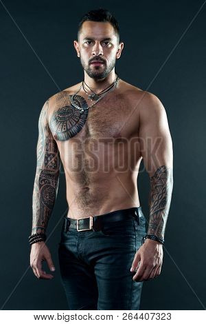 Muscular Tattooed Athlete Look Attractive. Sport And Fashion Concept. Handsome Fit Man Posing Wearin