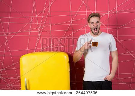 Man Sleepy Yawning Hold Morning Drink Near Refrigerator. Bachelor Hold Cup Of Tea Or Coffee At Retro