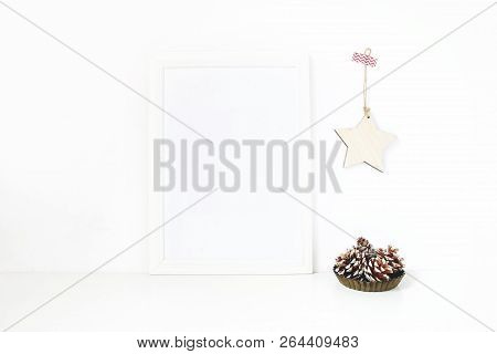 Vertical White Blank Wooden Frame Mockup. Pine Cones In Vintage Metal Bowl, White Table And Wooden S