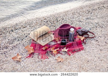 Autumn Mood On Sea Beach. Cozy Picnic With Hot Steamy Beverages, Tea, Coffee In Thermos, Warm Plaid,