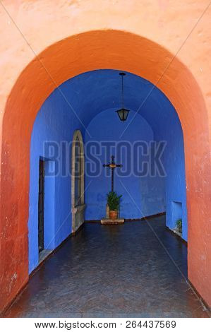 Bright Orange Colored Doorway Leading To Vivid Blue Chapel, Monastery Of Santa Catalina, Arequipa, P