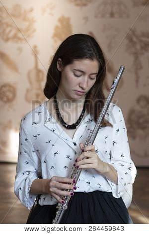 Music Performance. Stunning Elegant Young Lady With Transverse Flute Instrument