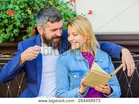 Common Interests. Couple In Love Sit Cafe Terrace. Man With Beard And Blonde Woman Cuddle On Romanti