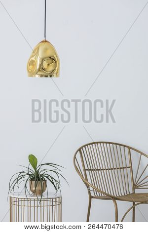 Stylish Golden Lap Above Industrial Table With Plant In Pot On It, Elegant Chair Next To It, Real Ph