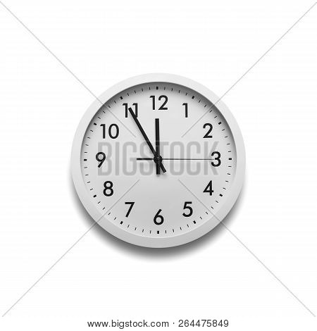 White Wall Clock Isolated On White Background. On The Clock, It Is Five To Midnight Or Five To Twelv