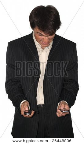 Angry businessman holding two mobile phones, isolated on white background