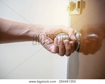 Close Up Of Hand Holding A Door Knob, Opening Or Closing The Door.