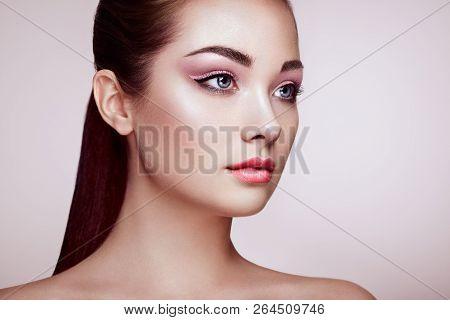 Beautiful Young Woman With Clean Fresh Skin. Perfect Makeup. Beauty Fashion. Eyelashes. Cosmetic Eye