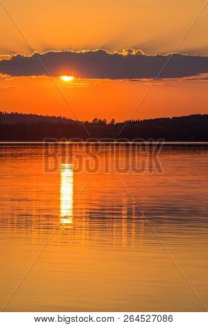 Colorful Sunset Landscape With Reflections In Water
