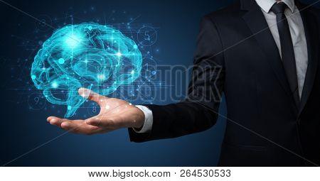 Businessman holding human brain on his hand with logistics symbols around