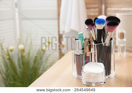 Organizer With Makeup Cosmetic Products And Space For Text On Dressing Table