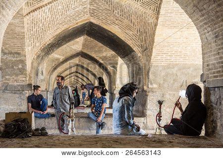 Isfahan, Iran - August 20, 2016 : Iranian Youngsters Gathering Under Si O Seh Pol Bridge Smoking Hoo