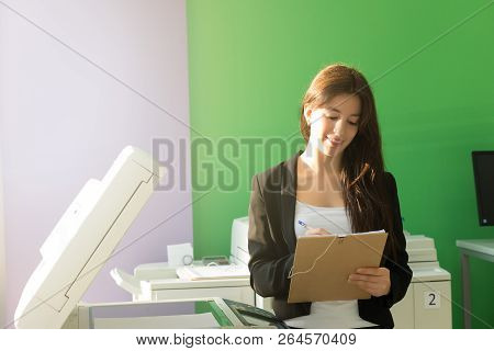 Young Student At A Copy Center