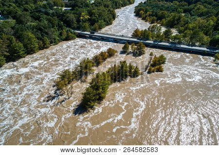 Chocolate Milkshake River Water After Major Flooding Event In Central Texas. Bridge At Red Bud Isle