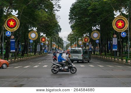 Ho Chi Minh City, Vietnam - August 23, 2017: Moving Traffic Crossing The Street In Hcmc In Vietnam