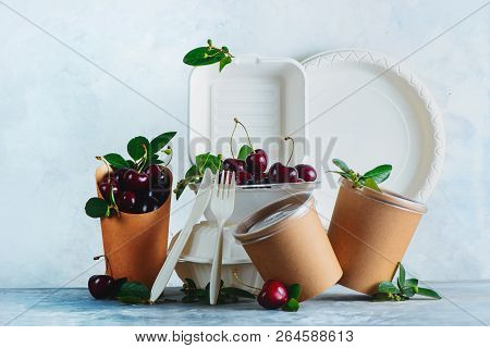Catering Disposables, Cups, Plates And Containers With Cherries. Eco-friendly Food Packaging On A Ne