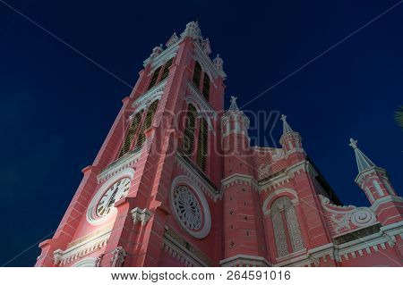 Tan Dinh Church Exterior Against Deep Blue Sky On The Background. Tan Dinh Church Is Popular Tourist