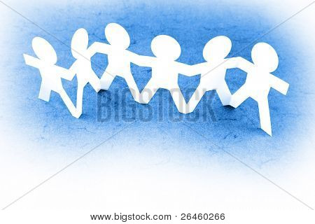 Line of paper doll people holding hands