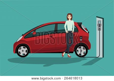 Woman Charges An Electric Car At A Charging Station.